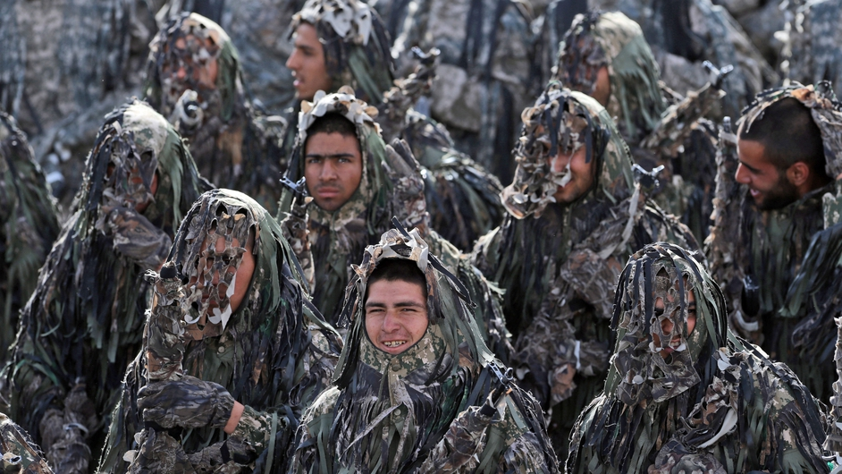 Iranian Army soldiers in camouflage march during a ceremony marking the annual National Army Day in Tehran