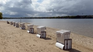 Beach chairs line up at lake Wannsee in Berlin, Germany, as the swimming season begins