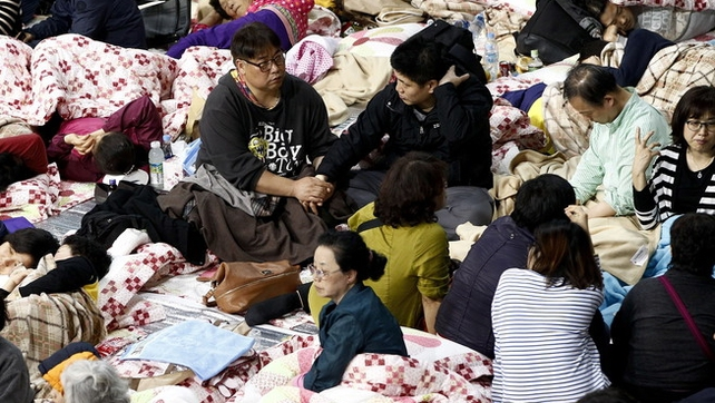 Grieving parents and others gathered in a gymnasium in the port of Jindo