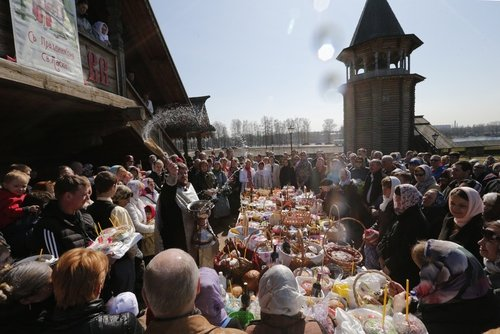 A Russian Orthodox priest blesses Easter food and believers at Pokrovsky Cathedral outside St Petersburg, Russia.