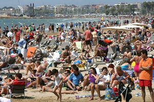 Thousands of sunbathers enjoying the warm temperatures of the Easter holiday on a beach in Spain.