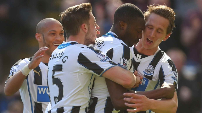 Local hero Shola Ameobi celebrates with team-mates after grabbing the opener at St James Park but it turned sour for Newcastle