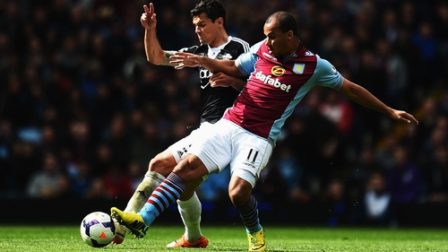 Dejan Lovren of Southampton (L) is challenged by Gabriel Agbonlahor of Aston Villa