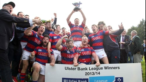 Clontarf players celebrate with the league trophy at Castle Avenue