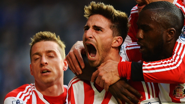 Fabio Borini (C) celebrates with team-mates after scoring his sides second goal from the penalty spot against Chelsea