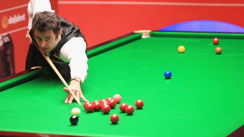 Ronnie O'Sullivan eased through to the second round in Sheffield
