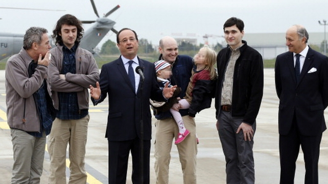 The journalists were greeted by French President Francois Hollande and their families