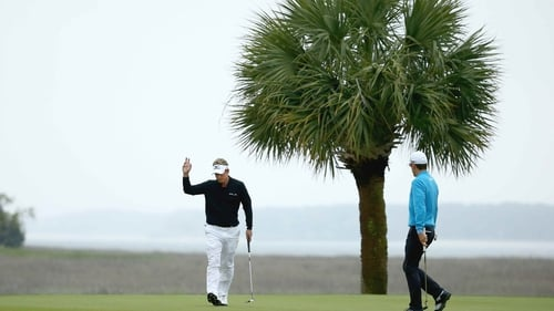 Luke Donald acknowledges the gallery as Scott Langley looks on