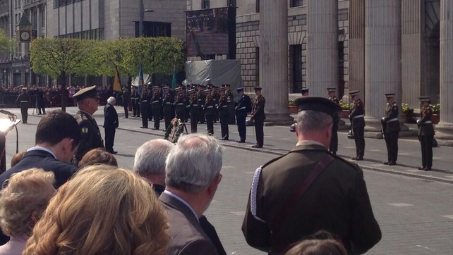 The president lays a wreath outside the GPO