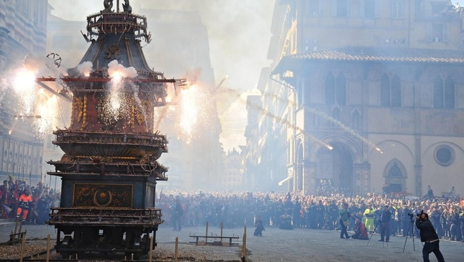 Locals and tourists attend the traditional event 'Scoppio del carro' (Explosion of the Cart) in Florence, Italy.