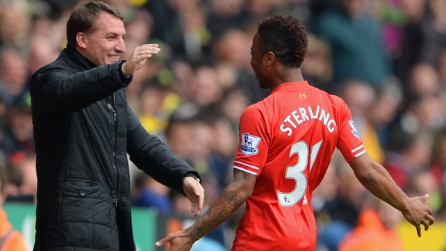 Raheem Sterling celebrates scoring the opening goal with Liverpool manager Brendan Rodgers