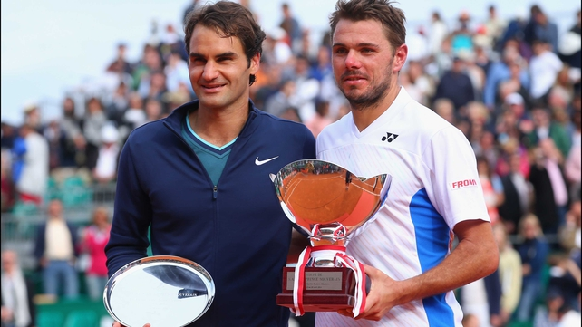 Winner Stanislas Wawrinka (R) alongside runner up Roger Federer