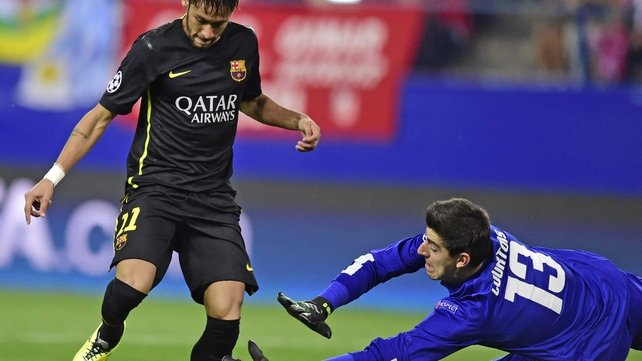 Thibaut Courtois in action for Atletico Madrid against Barcelona