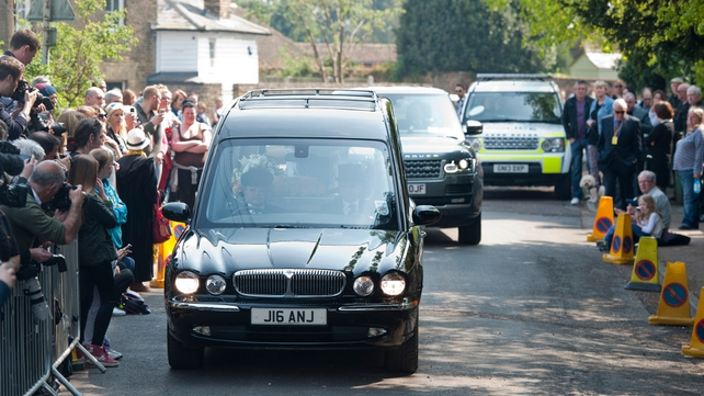The hearse carrying Peaches Geldof's coffin arrives at the church