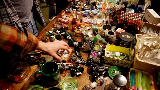 Attendees look at glass pipes sold at Hempfest in Seattle