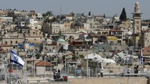 An Israeli flag flutters in Jerusalem's Old City