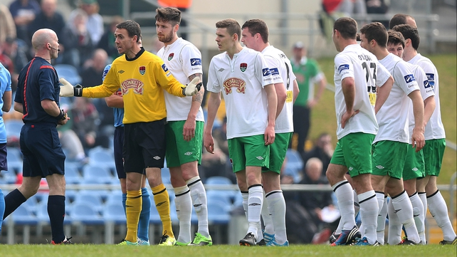 Cork City players led by goalkeeper Mark McNulty appeal to referee Padraig Sutton after he sent off Darren Dennehy (right of McNulty)
