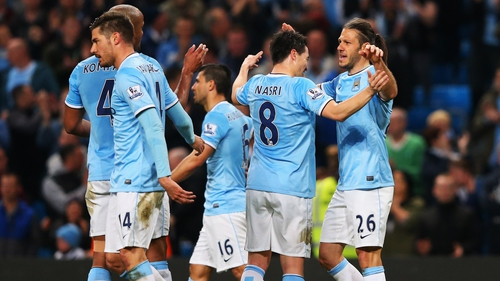 City players celebrate with Martin Demichelis after he scored the third at the Etihad Stadium