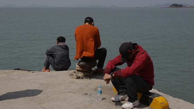 Relatives of missing passengers wait for news at Jindo port