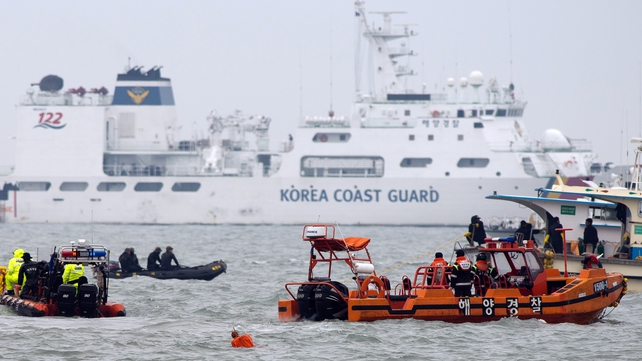 South Korean coastguards and rescue workers at the accident site in Jindo