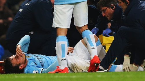 David Silva of Manchester City is given treatment during the match between Manchester City and West Bromwich Albion