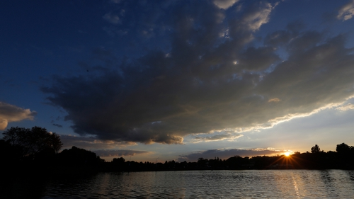 The sun rises over Emmarentia Dam in central Johannesburg, South Africa