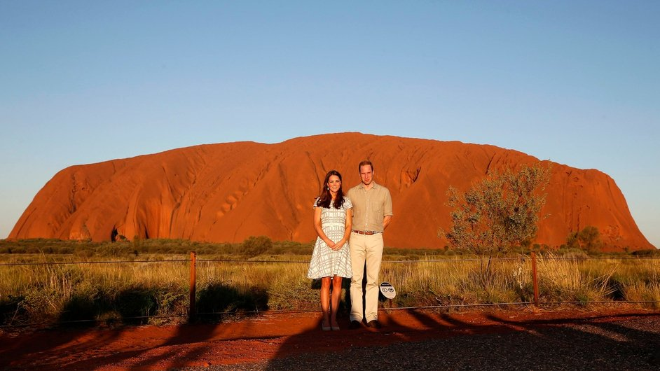 Catherine, Duchess of Cambridge and Prince William, Duke of Cambridge pose in front of Uluru (Ayers Rock) in Australia