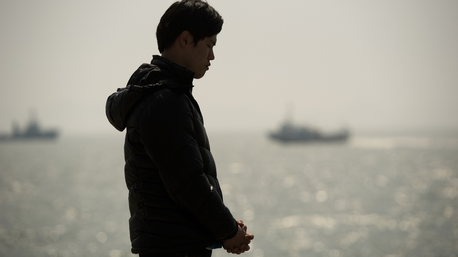 A relative of a passenger on the sunken South Korean ferry prays at Jindo harbour