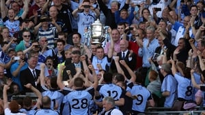 Dublin captain Johnny McCaffrey lifts the Bob O'Keeffe Cup in 2013