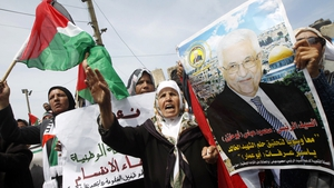 Palestinians hold a portrait of Mahmoud Abbas as they take part in demonstrations in support of a new attempt to reconcile with Hamas