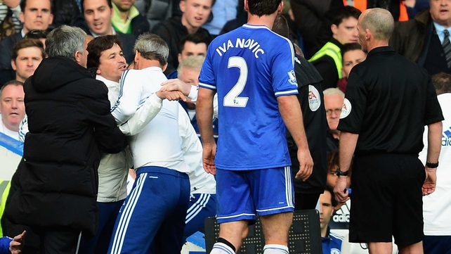 Chelsea coach Rui Faria is held back by Jose Mourinho as he confronts match referee Mike Dean