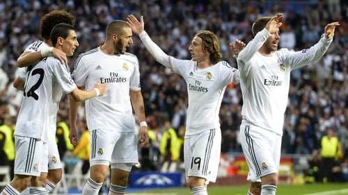 Madrid players celebrate Benzema's opener