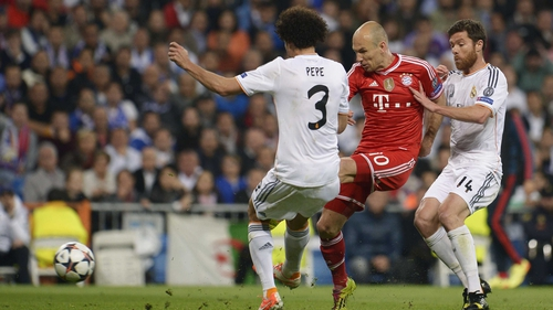 Arjen Robben tries to get a shot away under pressure from Madrid pair Pepe and Javi Alonso