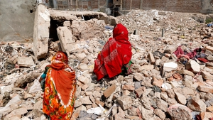 Two women visit the site of the Rana Plaza building collapse in Bangladesh (Pic: EPA)