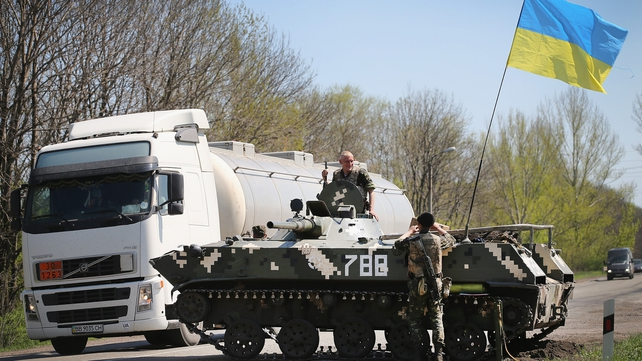 Ukrainian soldiers guard a roadblock along the motorway near Slaviansk