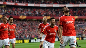 Benfica players rush to celebrate with goal scorer Ezequiel Garay