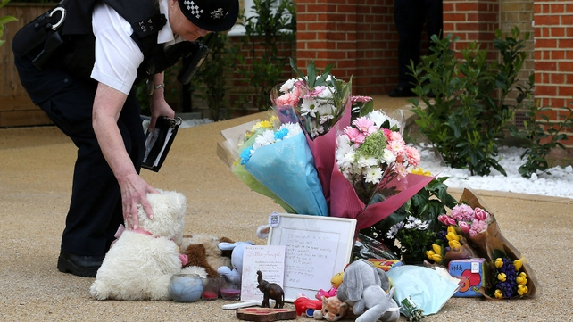 Floral tributes outside the house where the three children were found dead