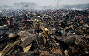 Fire Firefighters work at the scene of a fire that broke out in a slum area of New Delhi, India.