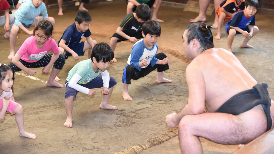 Children learn about sumo wrestling at Takanohana Beya in Tokyo