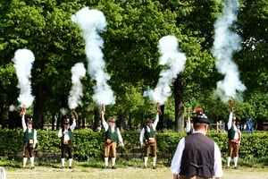 Shooters fire their guns at the Spring Festival on Theresienwiese in Munich, Germany