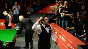 An elated Ronnie O'Sullivan punches the air as he leaves the auditorium following his victory over Joe Perry