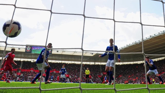 Seamus Coleman (R) holds his head in his hands as puts through his own goal