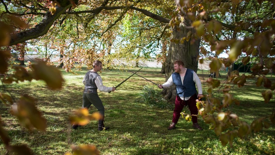 Actors practice a mock fight at the 'St George's Festival' at the Wrest Park estate in England