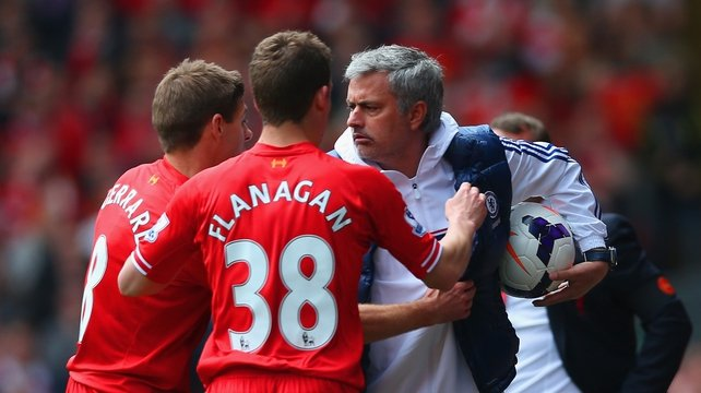 Jose Mourinho keeps the ball back from Steven Gerrard and Jon Flanagan