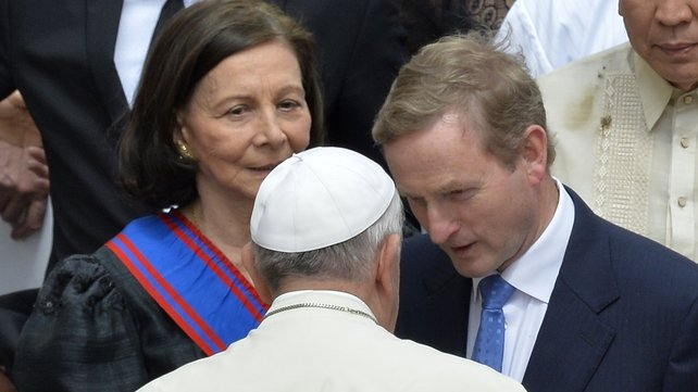 Enda Kenny speaks to Pope Francis after the canonisations this morning