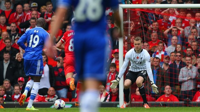 Chelsea's Demba Ba bears down on Simon Mignolet before scoring past the Liverpool 'keeper