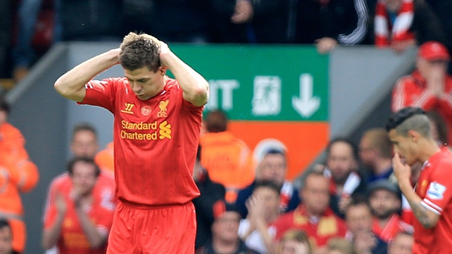 Steven Gerrard holds his head in hands after slipping up for Chelsea's opener