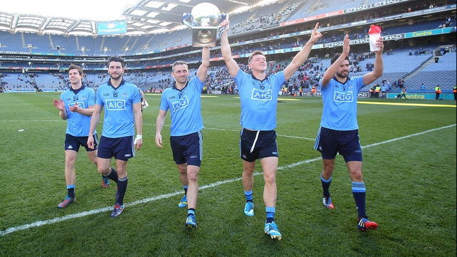 Dublin players with the League trophy after their resounding victory