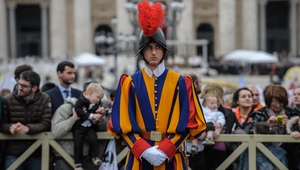 A Swiss Guard stands in St Peter's Square after the canonisations