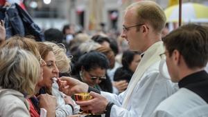 Pilgrims take communion in St Peter's Square
